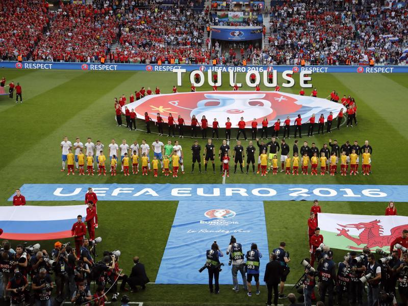 Teams stand during the playing of the national anthems during the Euro 2016 Group B football match between Russia and Wales at the Stadium municipal in Toulouse, France. (AP Photo)