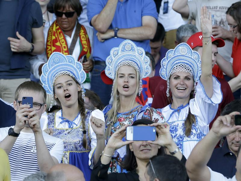 Russian fans wearing traditional outfits cheer from the stands before the Euro 2016 Group B football match between Russia and Wales at the Stadium municipal in Toulouse, France. (AP Photo)