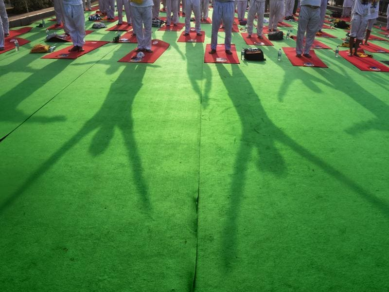 People participate in a mass yoga session to mark the 2nd International Yoga Day, in New Delhi.  (Raj K Raj/HT Photo)
