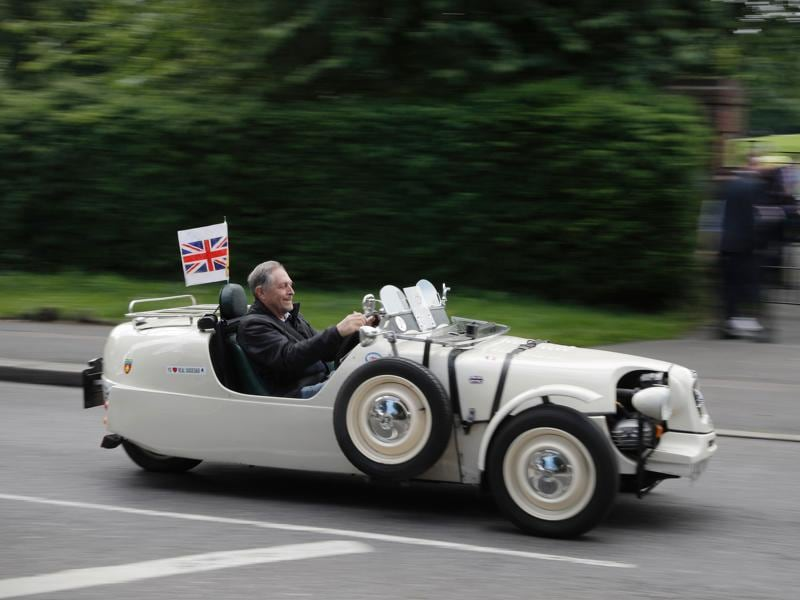 With the vote too close to call, both the Remain and Leave campaigns continued full-steam till the last possible minute, hoping to win the race. A Remain supporter zooms ahead in his three-wheel car at a rally two days ago.  (AFP/Adrian Dennis)