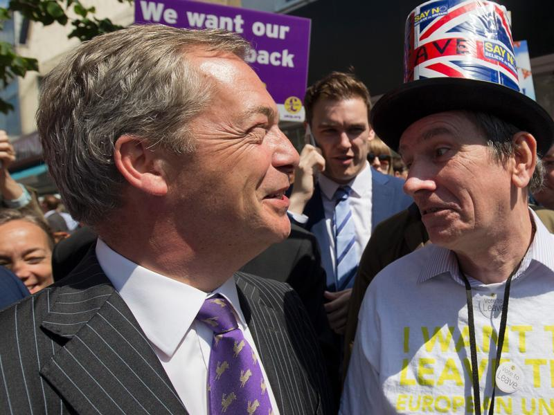 A Leave supporter poses in Clacton-on-Sea with Nigel Farage.  While Farage insists that  Britain will vote for Brexit, he has also hinted at the possibility of a second referendum if they lose by a small margin.  (AFP/Justin Tallis)