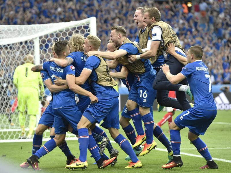 Iceland players celebrate a goal by Iceland's Arnor Ingvi Traustason during the Euro 2016 Group F match against Austria at the Stade de France in Saint-Denis, north of Paris, on June 22, 2016. Iceland won 2-1 to enter the round of 16 in their first appearance in a major international tournament. (AP)