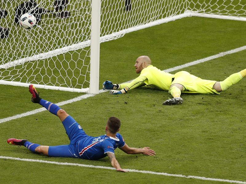 Iceland's Arnor Ingvi Traustason, bottom, scores his side's winning goal in the dying minutes of the match. (AP)