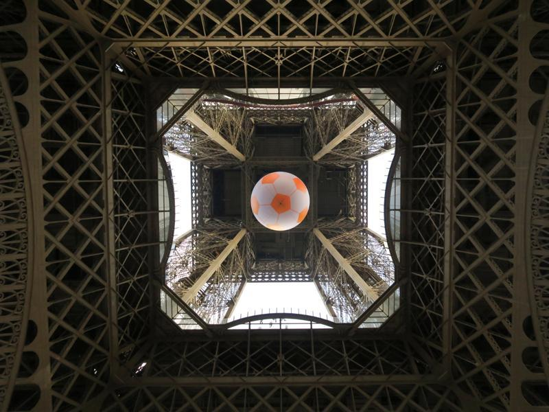 A giant football is suspended under the Eiffel Tower near the fan zone at the Champs de Mars.  (Reuters Photo)