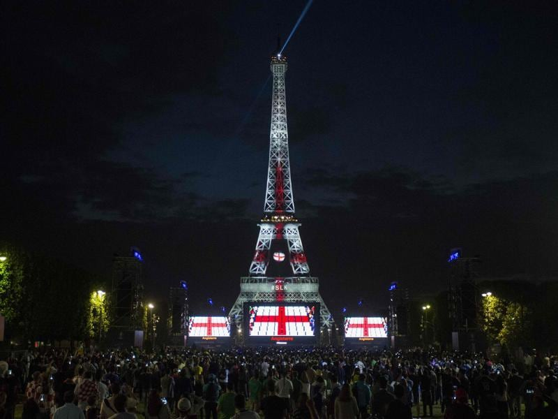 The Eiffel Tower is lit up with the England flag's colours during a football match between England and Russia, in Paris. (AFP Photo)