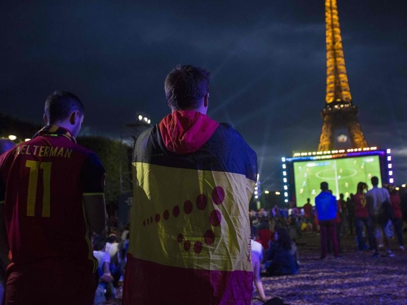 Belgium's supporter watch on a giant screen the Euro 2016 football match between Sweden and Belgium, at the fan zone in front of the Eiffel Tower in Paris. (AFP Photo)
