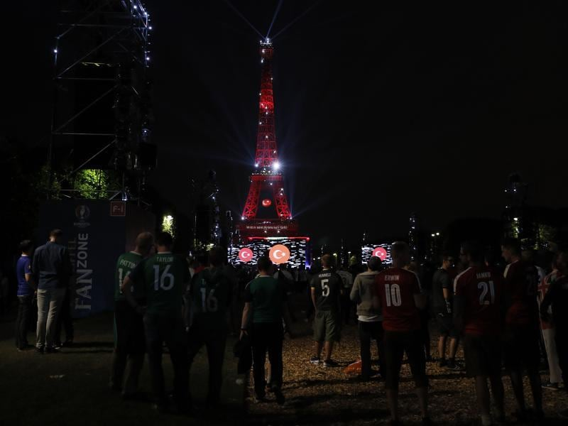 The Eiffel Tower is illuminated with colours of the Turkish flag after the screening of the Euro 2016 group D football match between Croatia and Spain. (AFP Photo)