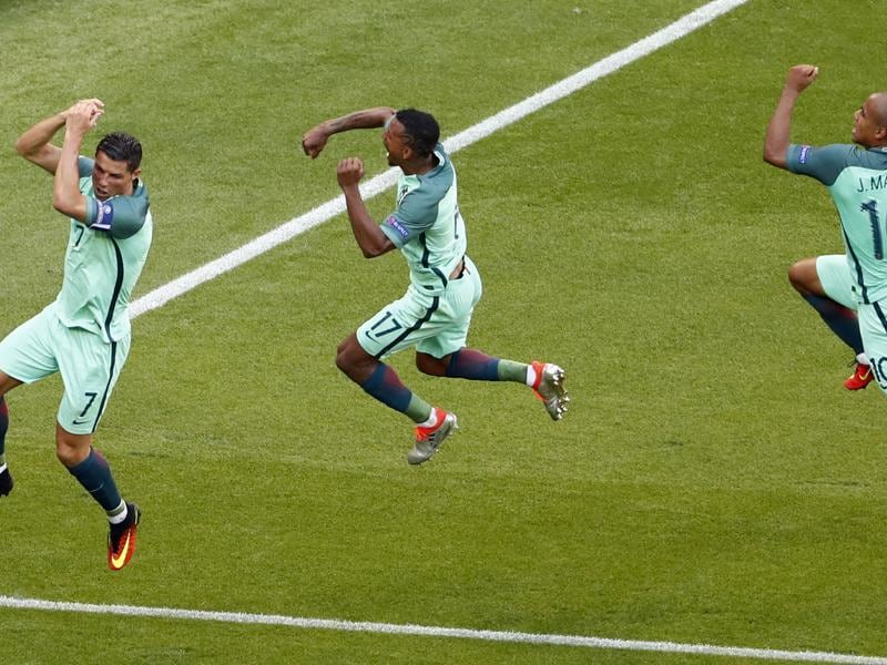 Ronaldo celebrates with Nani and Joao Mario after scoring Portugal's second goal. (REUTERS)