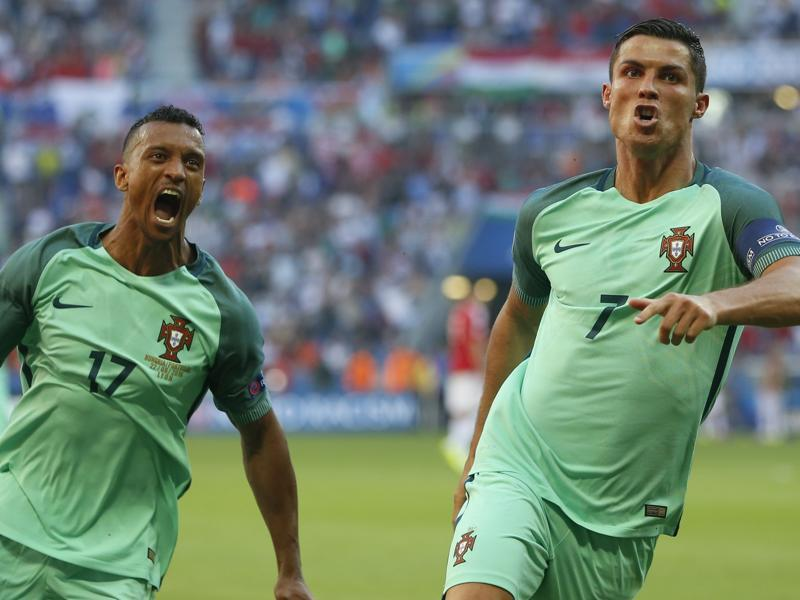 Ronaldo celebrates with Nani, left, after scoring Portugal's second goal. (AP)