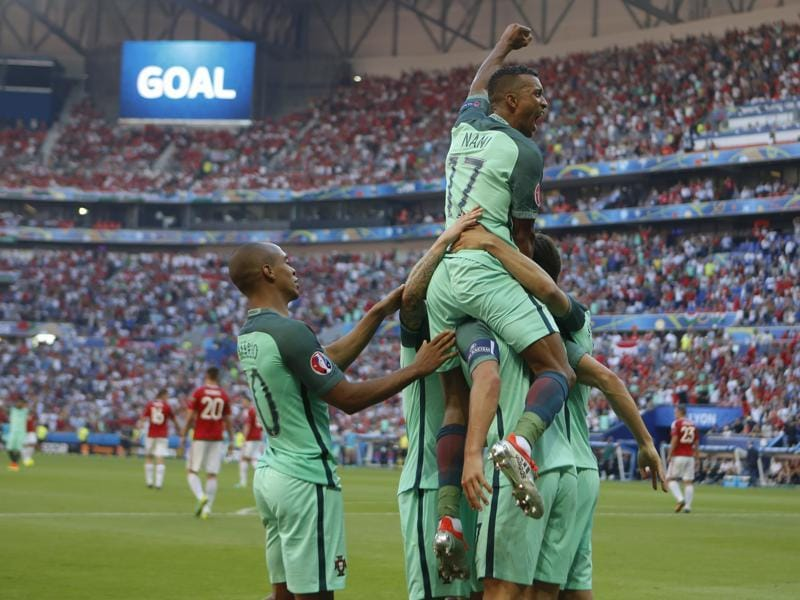 Nani, top, celebrates with teammates after Cristiano Ronaldo scored Portugal's second goal. (AP)