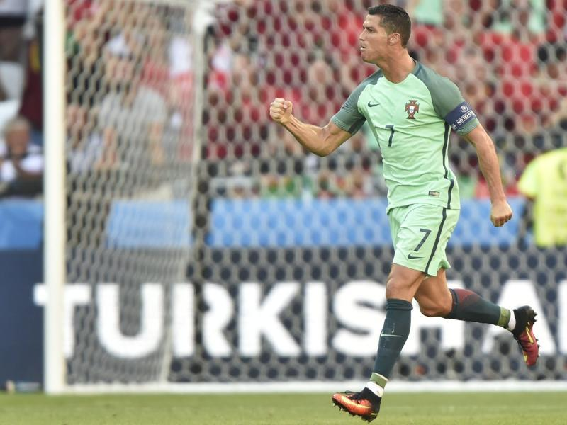 Cristiano Ronaldo of Portugal celebrates after scoring against Hungary during the Euro 2016 Group F match in Stade de Lyon in Lyon, France, on June 22, 2016. The match ended in a 3-3 draw, sending both teams into the round of 16. (AP)