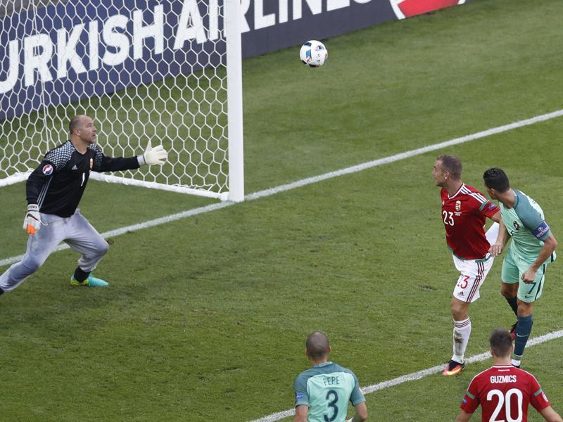 Ronaldo, right, heads in Portugal's third goal. (AP)