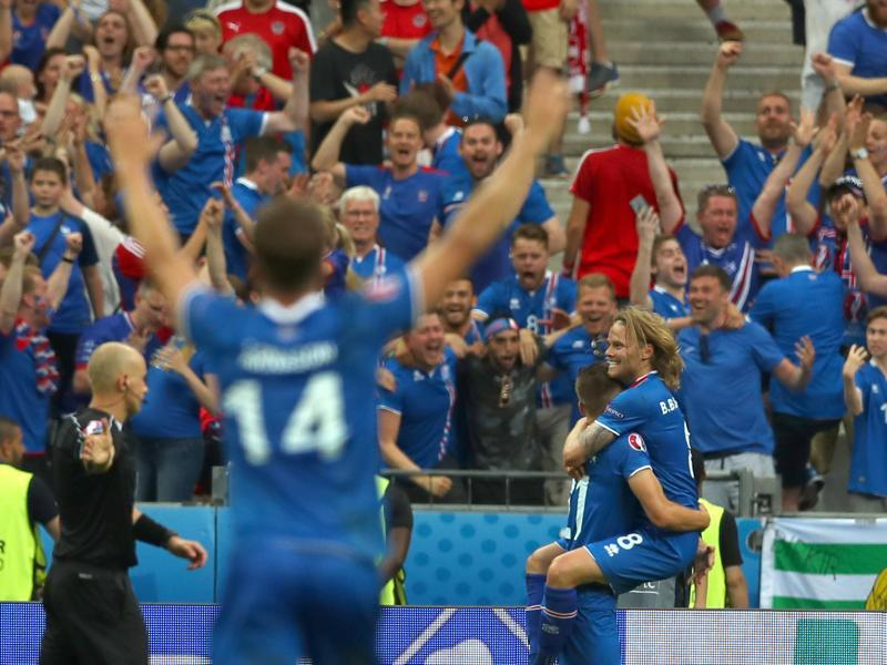 Iceland's Arnor Ingvi Traustason, celebrates his winning goal while carrying his teammate Birkir Bjarnason, right. (AP)