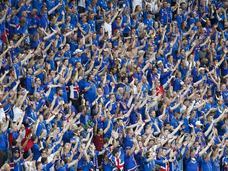 Iceland's fans cheer for their team. (AP)