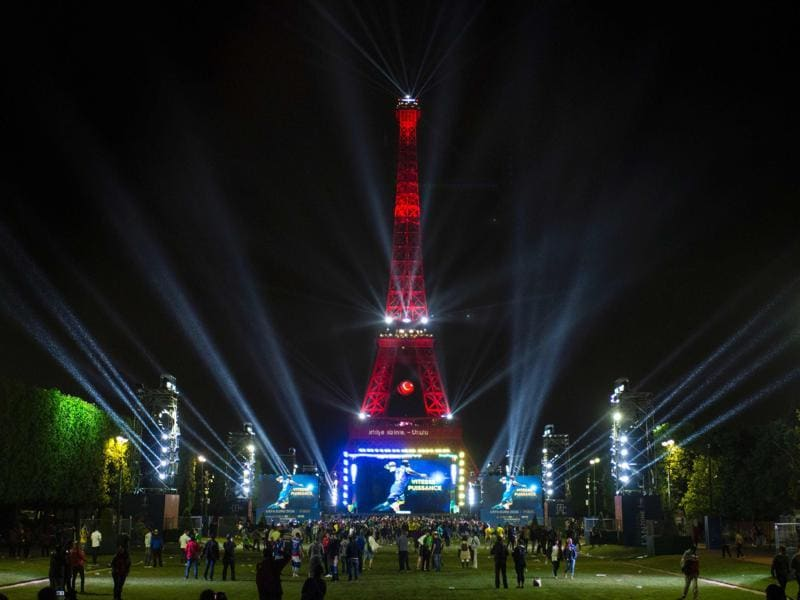 The Eiffel Tower is lit in Turkey flag's colours, as seen from the fan zone. (AFP Photo)