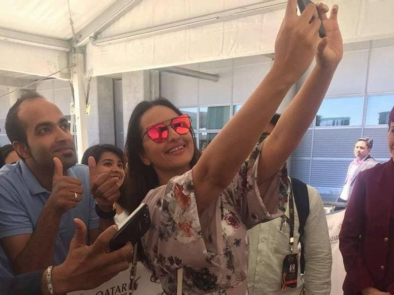 Sonakshi Sinha takes a selfie with fans at Adolfo Suarez Madrid-Barajas Airport as she arrives in Madrid to attend the IIFA Awards. (IANS)