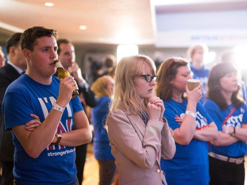 Supporters of the 'Stronger In' Campaign watch the results of the EU referendum being announced at a results party at the Royal Festival Hall in London on Friday.  (AFP)