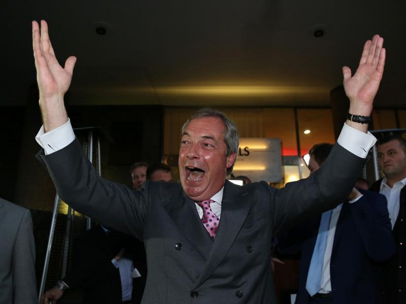 Leader of the United Kingdom Independence Party (UKIP), Nigel Farage reacts outside the Leave EU referendum party at Millbank Tower in central London as the results are declared. (AFP)