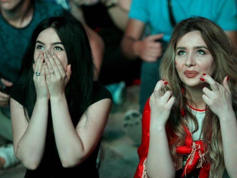 Albania fans react as they sit in the fan zone of Tirana during the Euro 2016 match between Albania and Romania on July 19 2016.  (AFP PHOTO)