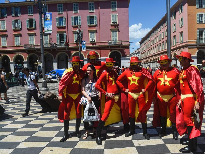 Spain supporters in Zorro costumes pose downtown Nice. (AFP Photo)