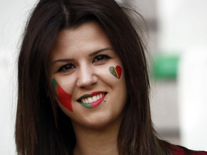 A Portugal supporter smiles prior to the Euro 2016 group F football match between Portugal and Iceland at the Geoffroy-Guichard stadium in Saint-Etienne. (AFP Photo)