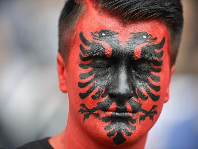 An Albania supporter closes his eyes as he waits for the start of the Euro 2016 group A football match between Albania and Switzerland at the Bollaert-Delelis Stadium in Lens on June 11, 2016.  (AFP PHOTO)