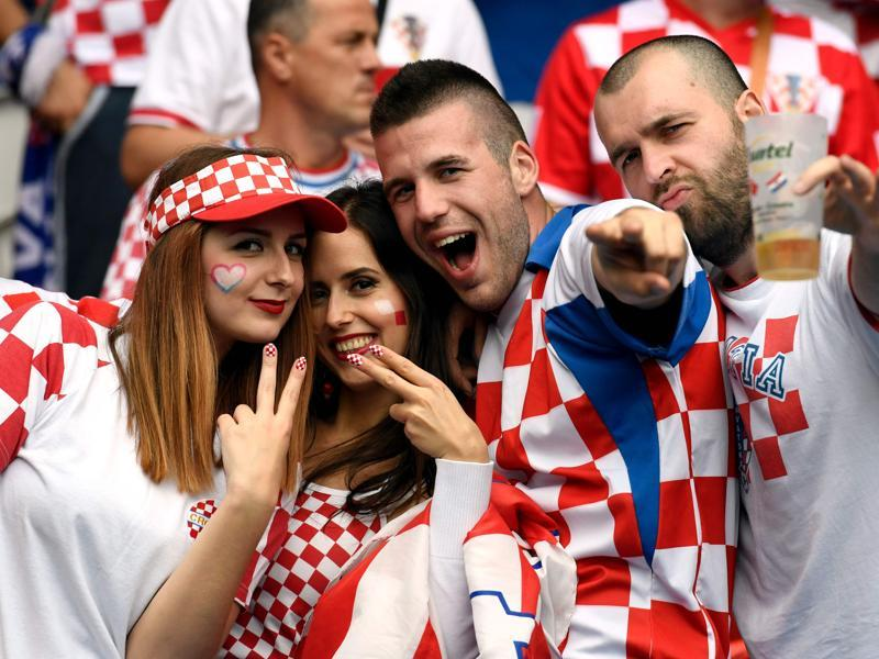 Croatia fans pose for pictures ahead of the start of the Euro 2016 group D football match between Turkey and Croatia at the Parc des Princes in Paris on June 12, 2016. (AFP PHOTO)