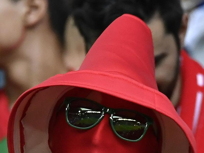 A Portugal fan dressed up as a in the colours of Portugal waits for the start of the Euro 2016 group F football match between Portugal and Iceland at the Geoffroy-Guichard stadium . (AFP PHOTO)