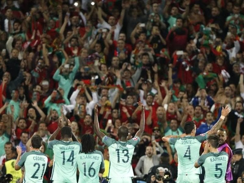 Portugal players celebrate after the game. (Reuters)