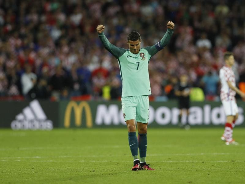 Cristiano Ronaldo celebrates at the end of the match. (REUTERS)