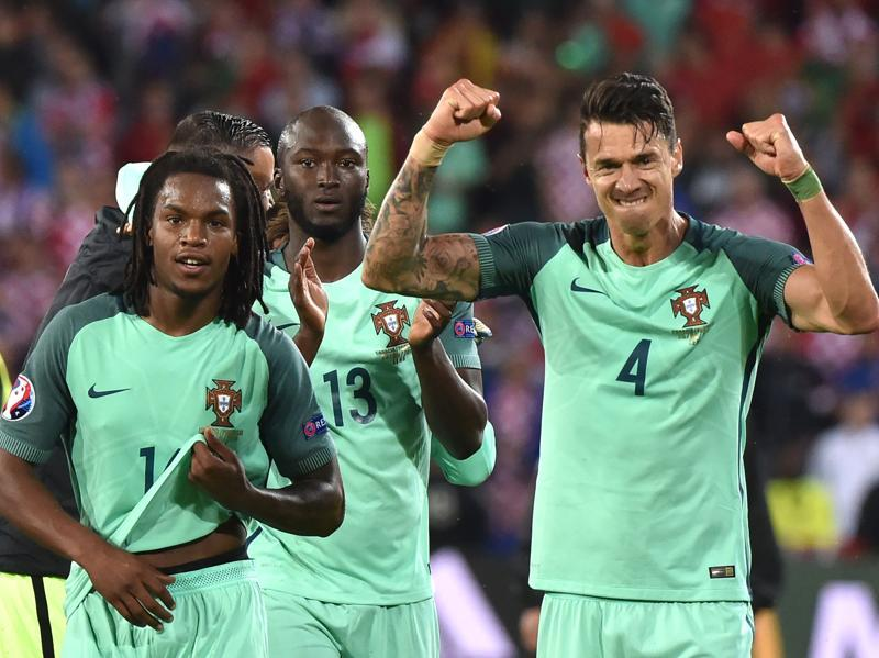 Portugal's Renato Sanches (L), Danilo Pereira (C) and Fonte celebrate their team's victory. (AFP)