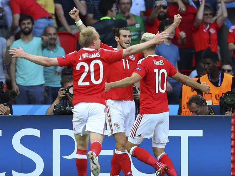 From left, Wales's Jonathan Williams, Wales's Gareth Bale and Wales's Aaron Ramsey celebrate. (AP photo)