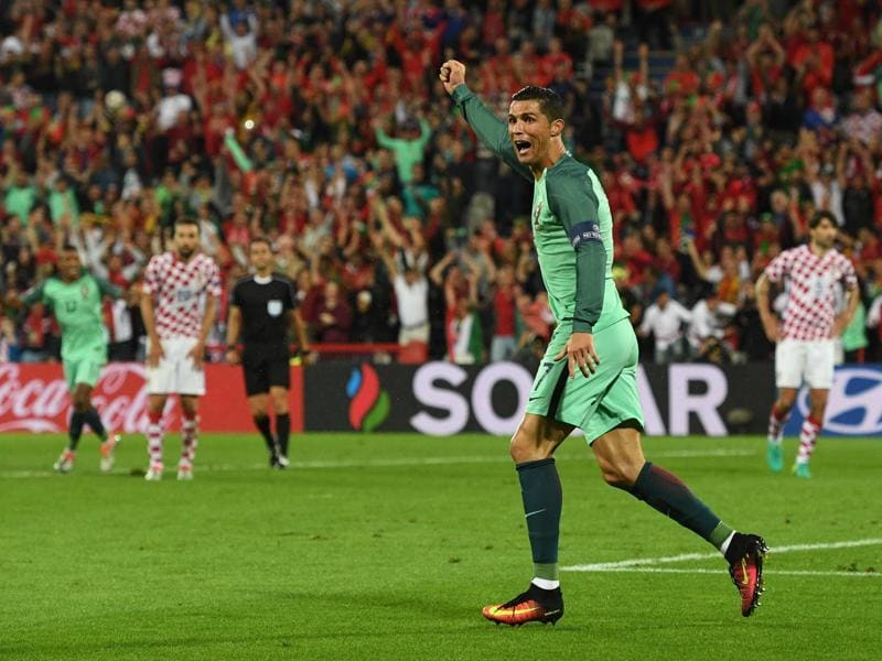Portugal's Cristiano Ronaldo celebrates after teammate Ricardo Quaresma scores during the Euro 2016 round-of-16 match against Croatia on June 25, 2016, at the Bollaert-Delelis stadium in Lens, France. Portugal won 1-0. (AFP)