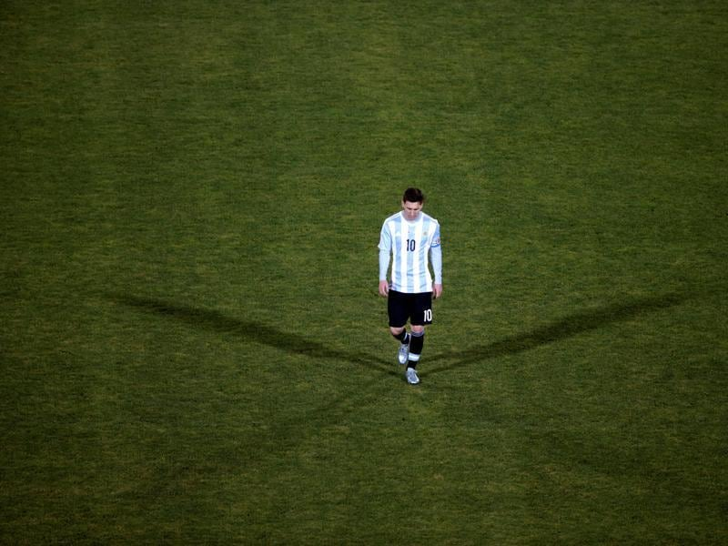 Argentina's Lionel Messi reacts after his team's loss to Chile in their Copa America 2015 final soccer match at the National Stadium in Santiago, Chile. (REUTERS)