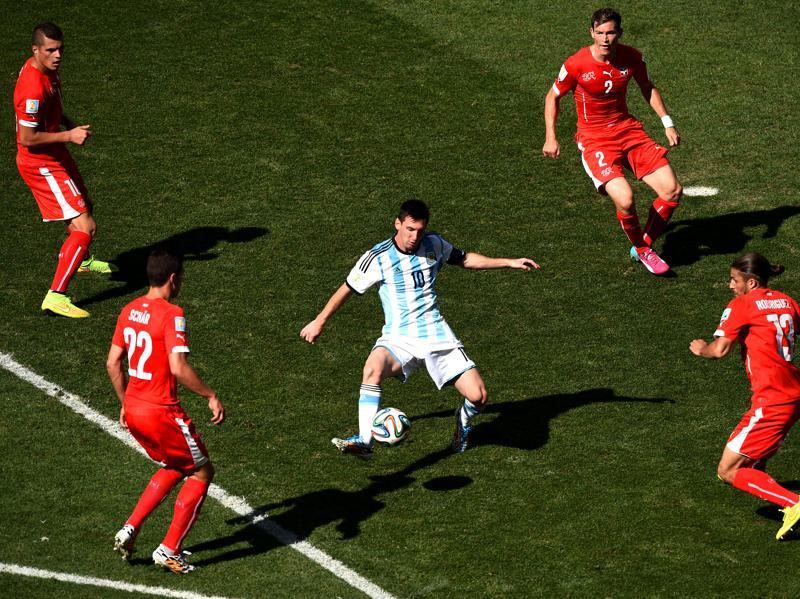 Lionel Messi of Argentina controls the ball against Josip Drmic (L), Fabian Schar (2nd L), Stephan Lichtsteiner (2nd R) and Ricardo Rodriguez of Switzerland during the 2014 FIFA World Cup Brazil Round of 16 match between Argentina and Switzerland at Arena de Sao Paulo on July 1, 2014 in Sao Paulo, Brazil.  (Getty Images)