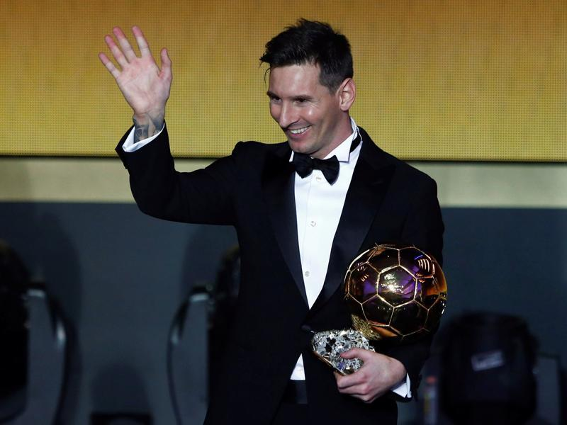 FC Barcelona's Lionel Messi of Argentina holds the World Player of the Year award during the FIFA Ballon d'Or 2015 ceremony in Zurich, Switzerland. (REUTERS)