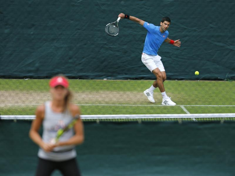 Novak Djokovic of Serbia returns the ball during a training session. (AP)