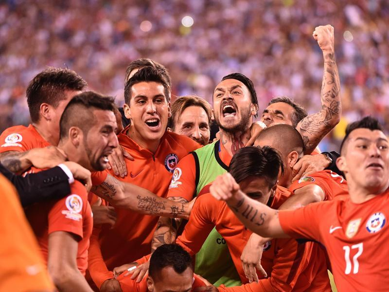 Chile's players celebrate their win. (AFP)