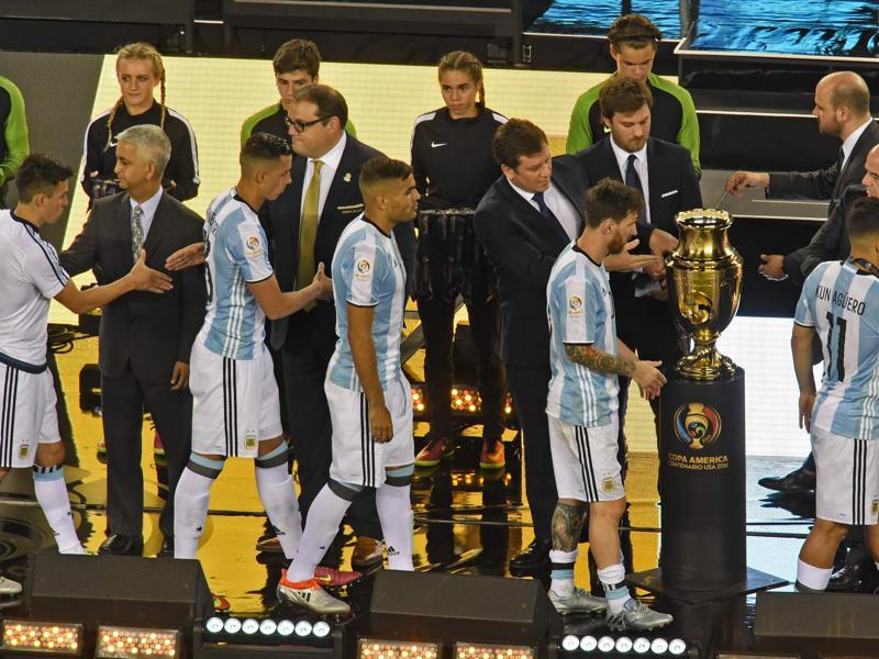 Argentine players receive their second-place medals during the awards ceremony. (AFP)