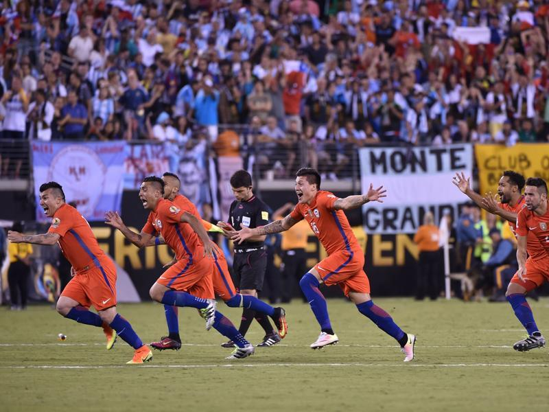 Chilean players set off in celebration after the final penalty. (AFP)