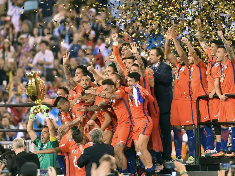 Confetti falls as Chile, led by Claudio Bravo, celebrate their win. (AFP)