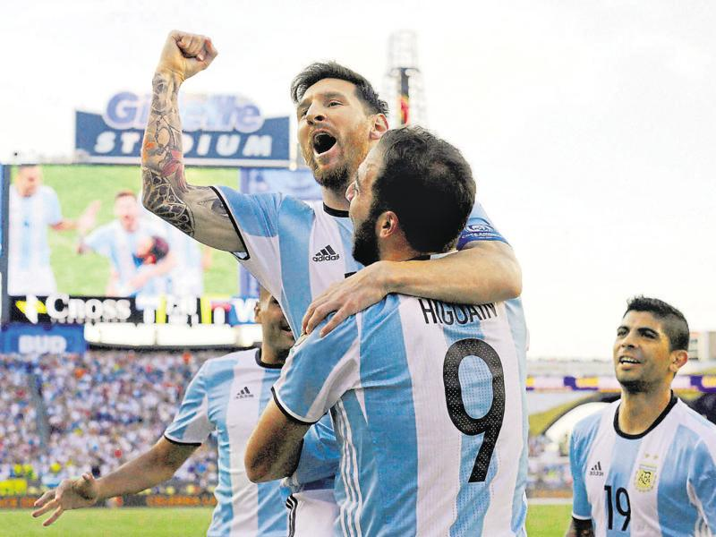 Argentina's Lionel Messi, top, celebrates a goal by Gonzalo Higuain (9) during the first half of a Copa America Centenario quarterfinal. (AP Photo)
