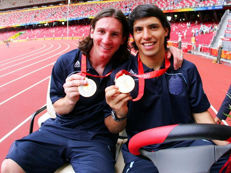 Argentinian forwards Lionel Messi (L) and Sergio Aguero gold medal pose during the men's Olympic football tournament medal ceremony at the national stadium in Beijing during the Men's Final between Nigeria and Argentina at the National Stadium on Day 15 of the Beijing 2008 Olympic Games. (Getty Images)