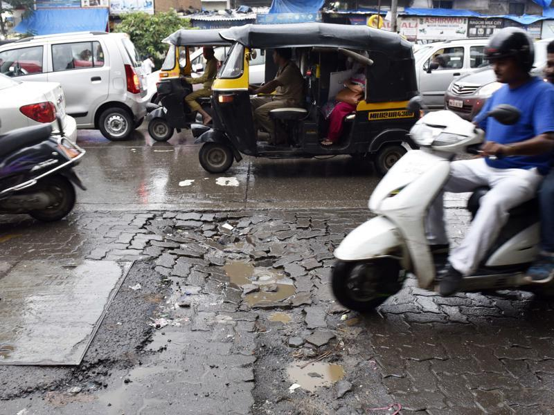 The city isn't ready for the monsoon as potholes show up across Mumbai. The crevices pose a major threat to commuters who have to dodge the cracks amid heavy showers.  (Vidya Subramanian)