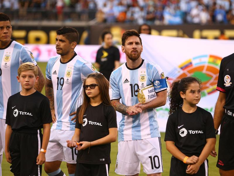 Lionel Messi (10) looks on during player introductions prior to the start of the match. (Reuters)