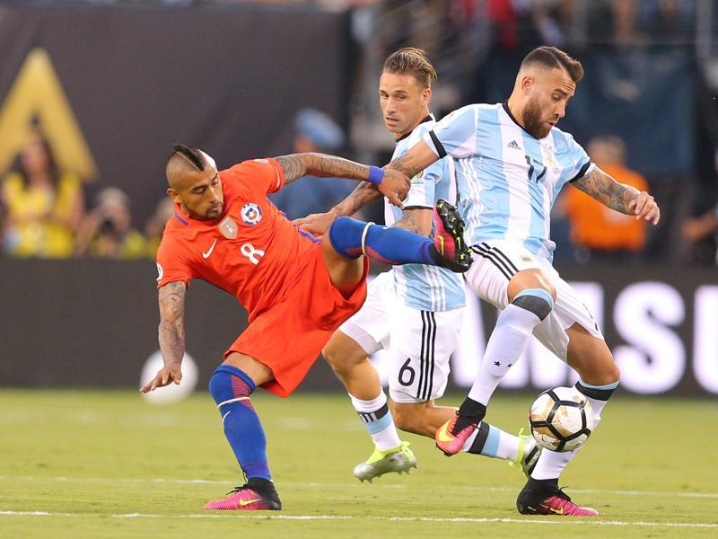 Argentina defender Nicholas Otamendi (17) battles for the ball with Chile midfielder Arturo Vidal (8). (Reuters)