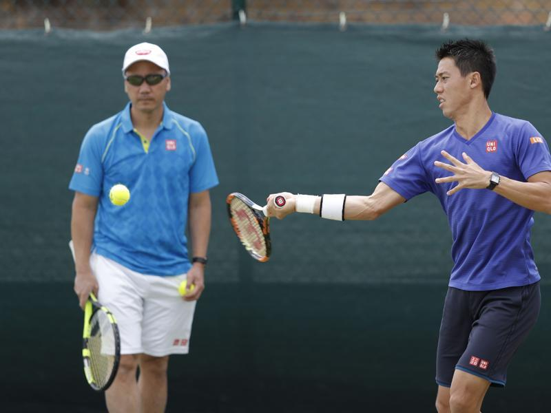 Japan's Kei Nishikori (R) plays a shot during a practice session, overseen by Michael Chang. (AFP)