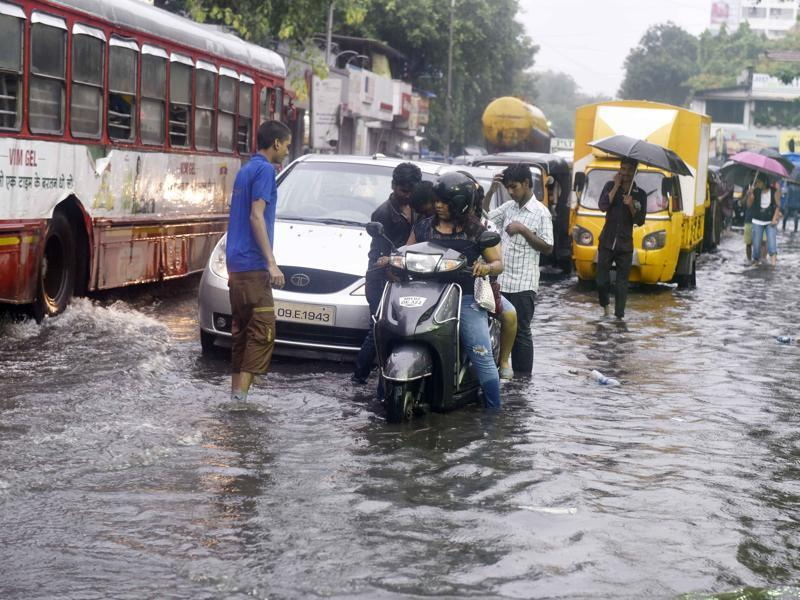 Traffic snarl is a fallout of heavy rain. This, however, doesn't stop residents from stepping out of home.  (Vidya Subramanian)