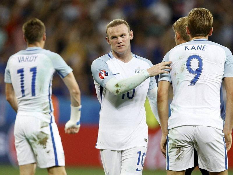 England's Wayne Rooney comforts his teammates at the end of  their Euro  run. (AP PHOTO)