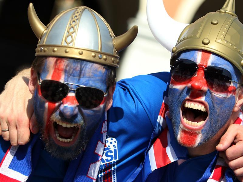 Iceland's supporters cheer  channelling  their  viking spirit. (AFP Photo)